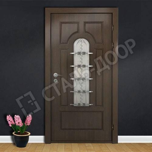 Фото металлических дверей с элементами ковки